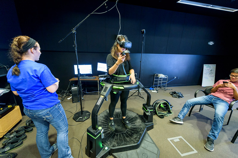Students use virtual and augmented reality gear during a demonstration in the Envision Center, on the second day of the Dawn Or Doom conference. (Purdue University Photo/Alex Kumar)