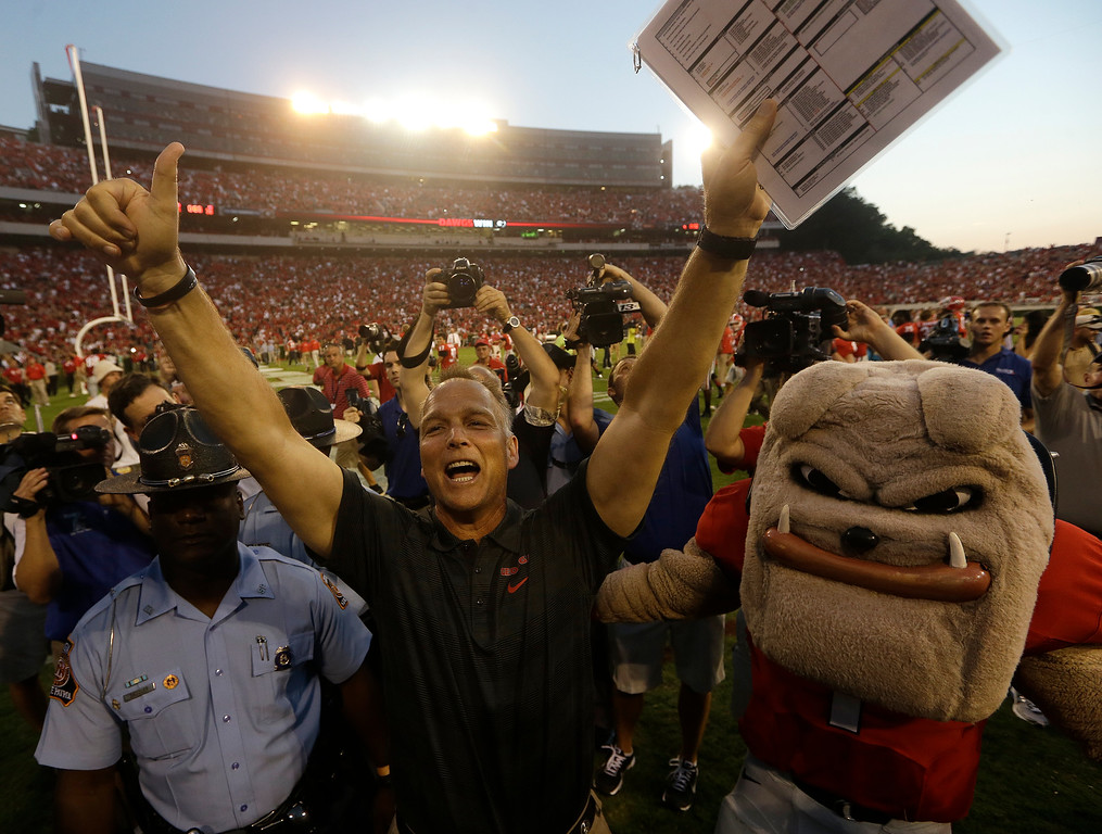 . Georgia head coach Mark Richt celebrates with the fans after the second half of an NCAA football game against the South Carolina, Saturday, Sept. 7, 2013, in Athens, Ga. Georgia won 41-30. (AP Photo/John Bazemore)