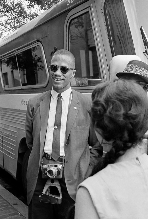 . Malcolm X, head of the Washington Black Muslims,  chats with people outside the Justice Department on 9th Street in Washington D.C. on June 14, 1963 during a civil rights parade. (AP Photo/Bob Schutz)