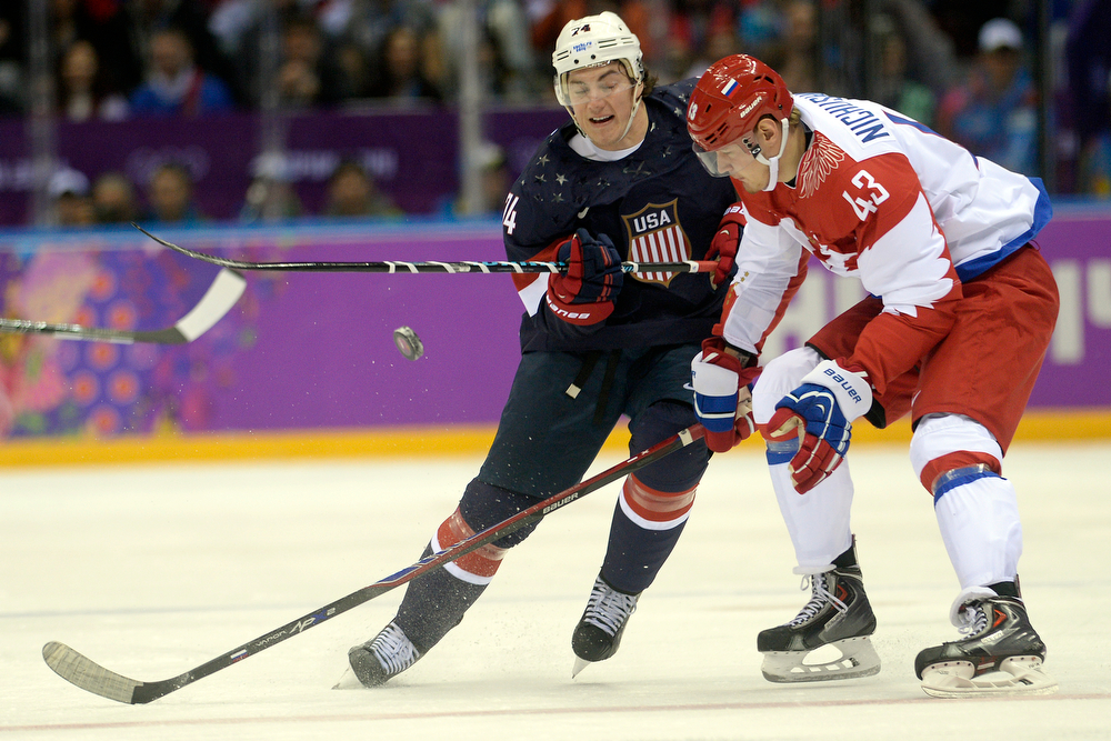 . T.J. Oshiet (74) of the U.S.A. loses the puck as Valeri Nichushkin (43) of the Russia defends during the first period of men\'s hockey action at Bolshoy arena. Sochi 2014 Winter Olympics on Saturday, February 15, 2014. (Photo by AAron Ontiveroz/The Denver Post)