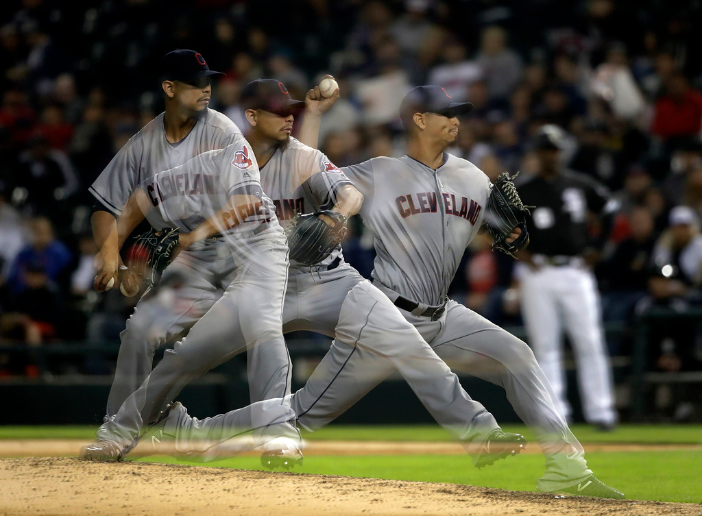 . Cleveland Indians starting pitcher Carlos Carrasco delivers in this in-camera triple exposure during the seventh inning of a baseball game against the Chicago White Sox Monday, June 11, 2018, in Chicago. (AP Photo/Charles Rex Arbogast)