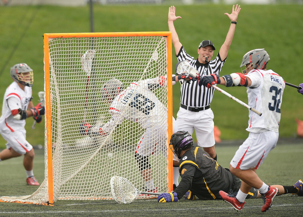 . United States attack Rob Pannell (32) put a shot past Iroquois goaltender Warren Hill (1) in the first half.     Photo by Karl Gehring/The Denver Post