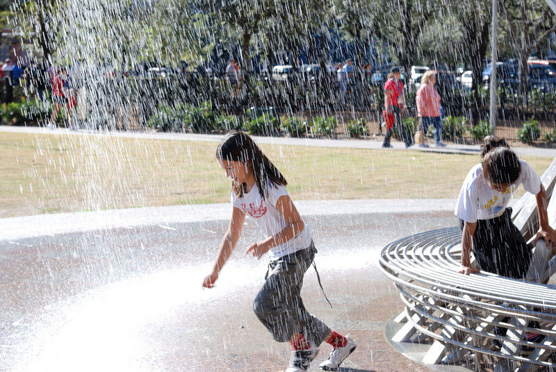 Houston - children playing in the water fountain.