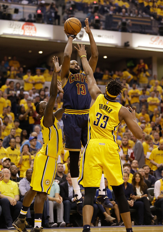 . Cleveland Cavaliers\' Tristan Thompson (13) shoots during the first half in Game 3 of a first-round NBA basketball playoff series against the Indiana Pacers, Thursday, April 20, 2017, in Indianapolis. (AP Photo/Michael Conroy)