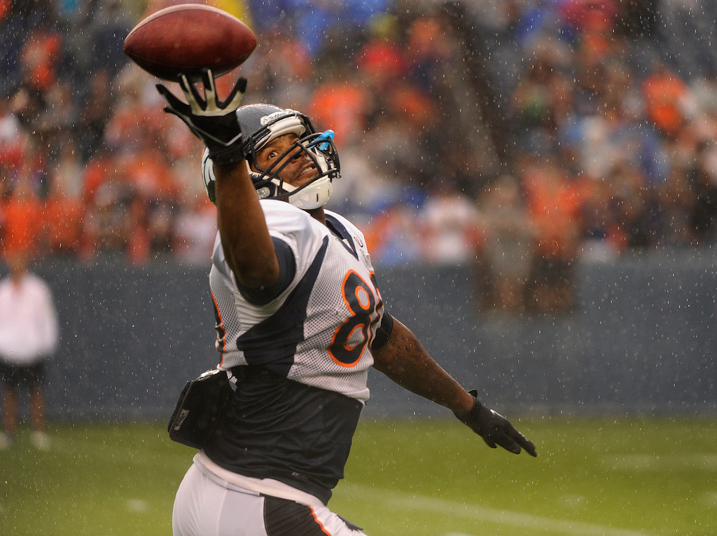 . DENVER, CO. - AUGUST 03: Tight end Julius Thomas got his hands on a wet ball to make a catch during practice Saturday. The Denver Broncos practiced in the rain at Sports Authority Field Saturday night, August 3, 2013. Photo By Karl Gehring/The Denver Post