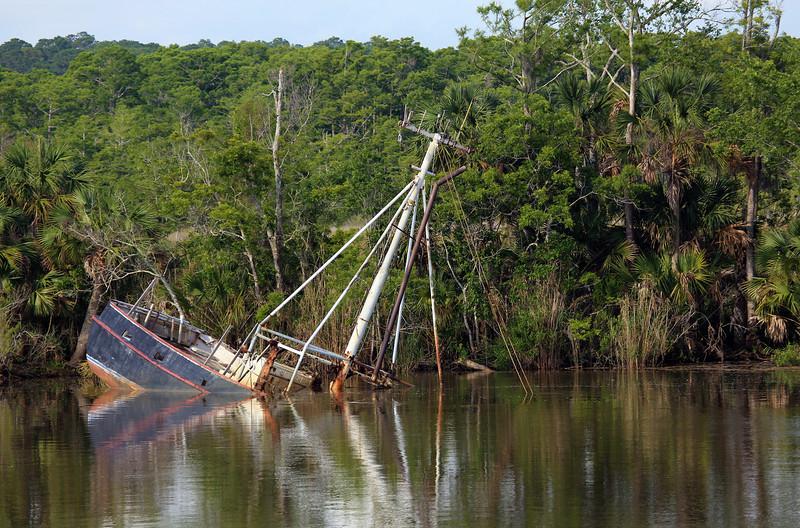A sunken boat greets us.
