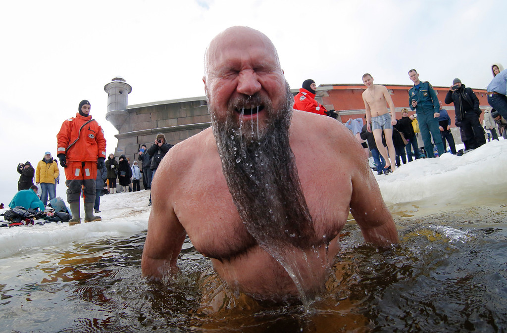 . A Russian Orthodox believer bathes in the icy water on Epiphany in the Neva River in St.Petersburg, Russia, Tuesday, Jan. 19, 2016. The temperature in St.Petersburg is minus 5 Celsius (23 Fahrenheit). Thousands of Russian Orthodox Church followers plunged into icy rivers and ponds across the country to mark Epiphany, cleansing themselves with water deemed holy for the day. Water that is blessed by a cleric on Epiphany is considered holy and pure until next year\'s celebration, and is believed to have special powers of protection and healing.(AP Photo/Dmitry Lovetsky)