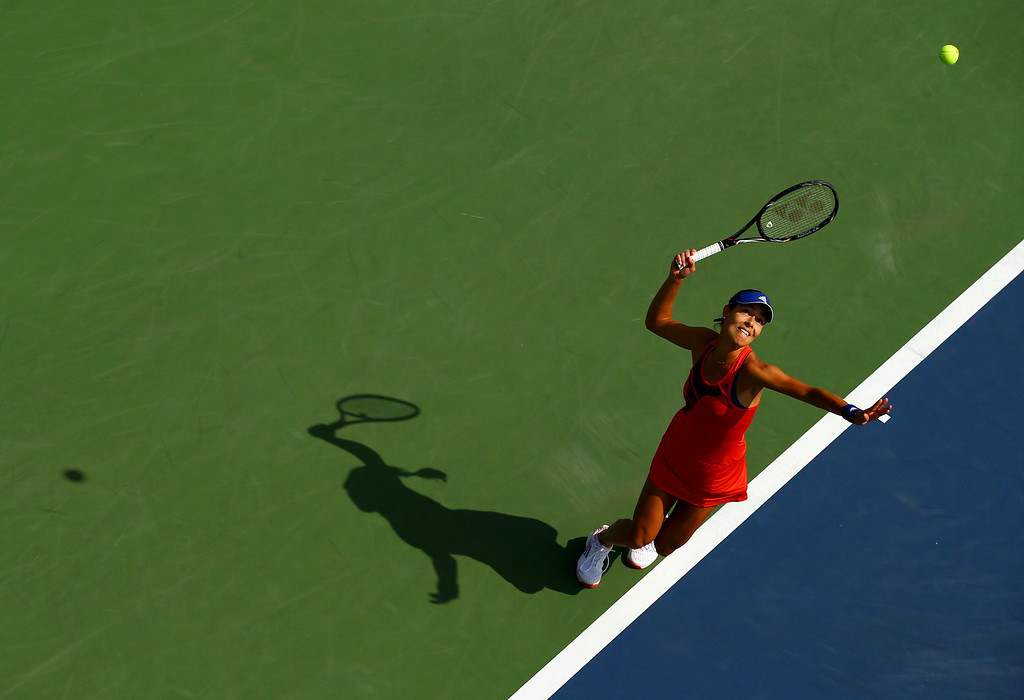 . NEW YORK, NY - AUGUST 26:  Ana Ivanovic of Serbia serves during her women\'s singles first round match against Anna Tatishvili of Georgia on Day One of the 2013 US Open at USTA Billie Jean King National Tennis Center on August 26, 2013 in the Flushing neighborhood of the Queens borough of New York City.  (Photo by Al Bello/Getty Images)