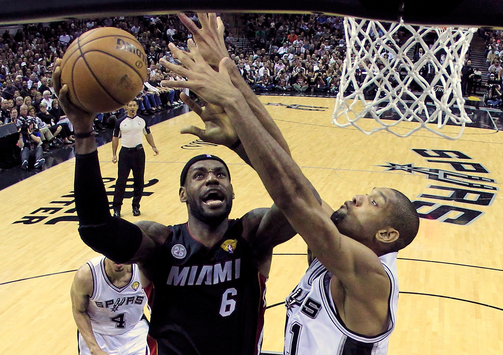 . Miami Heat\'s LeBron James (6) goes to the basket against San Antonio Spurs Tim Duncan (R) in the first half during Game 4 of their NBA Finals basketball series in San Antonio, Texas June 13, 2013.  REUTERS/Lucy Nicholson