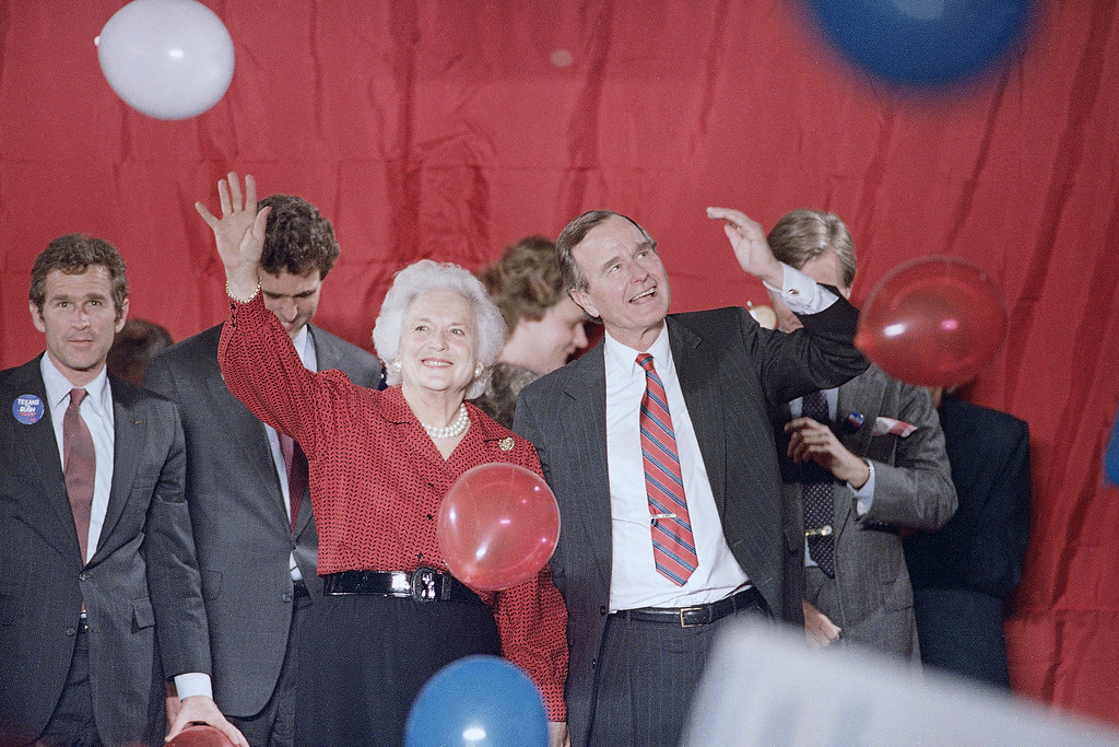 . Vice President George H. Bush and Barbara Bush wave as balloons are dropped during a welcome rally in Houston, Nov. 8, 1988.  Bush will watch the election results in Houston on Tuesday. (AP Photo/John Duricka)