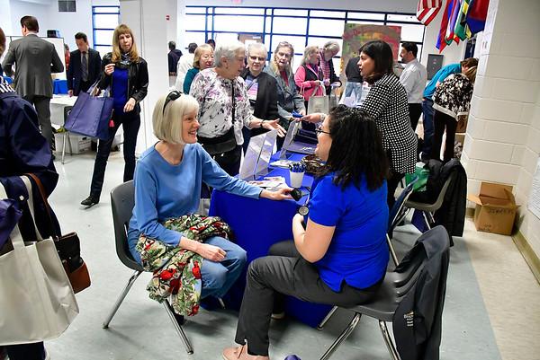 4/6/2019 Mike Orazzi | Staff Bristol Heath's Maria Rivera checks Susan Taylor's blood pressure during the 5th Annual Connecticut Prime Time Senior Fair Saturday at Bristol Eastern High School.
