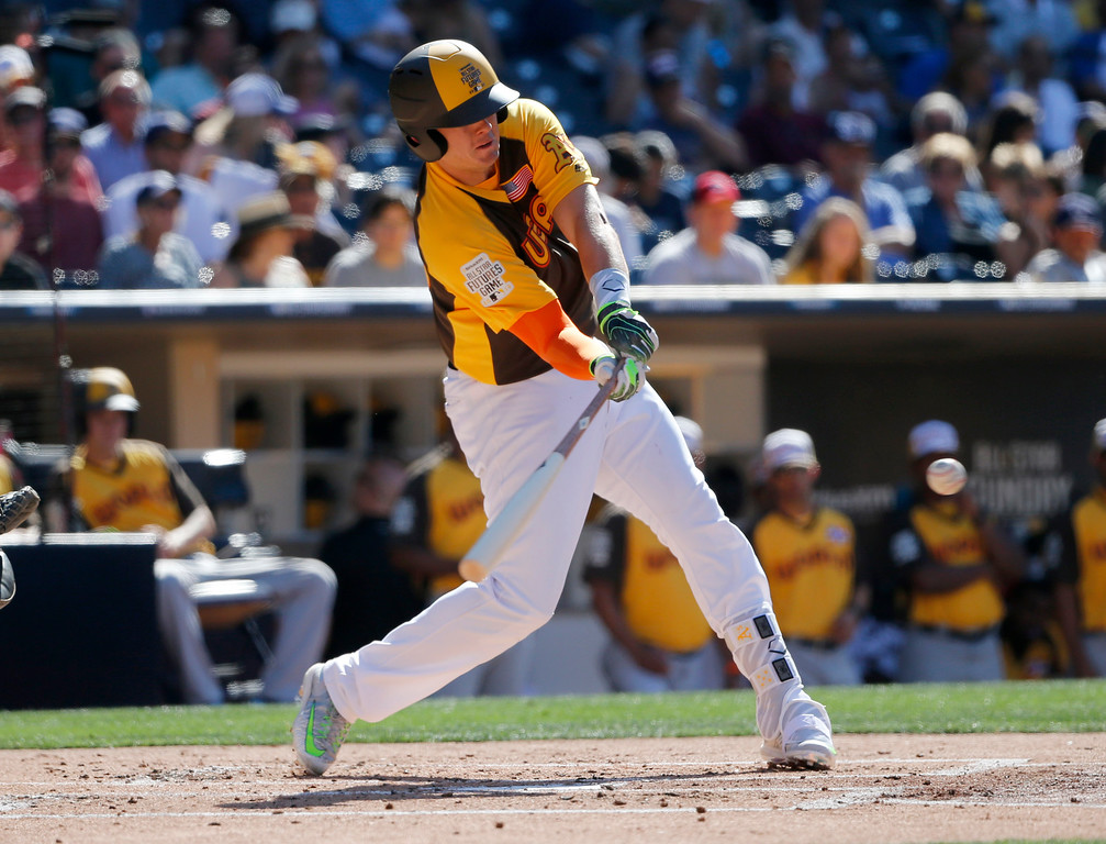 . U.S. Team\'s Ryon Healy, of the Oakland Athletics, hits against the World Team during the second inning of the All-Star Futures baseball game, Sunday, July 10, 2016, in San Diego. (AP Photo/Lenny Ignelzi)