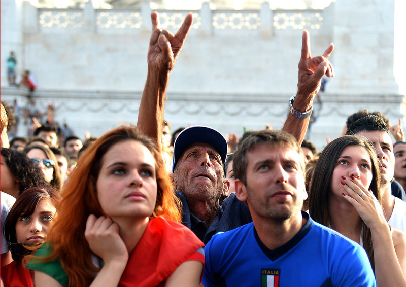 . An Italy fan gestures as he reacts to the expulsion of Italian footballer Claudio Marchisio as he watches the FIFA World Cup 2014 Group D football match Italy vs Uruguay on a giant screen in central Rome on June 24 , 2014. (ALBERTO PIZZOLI/AFP/Getty Images)
