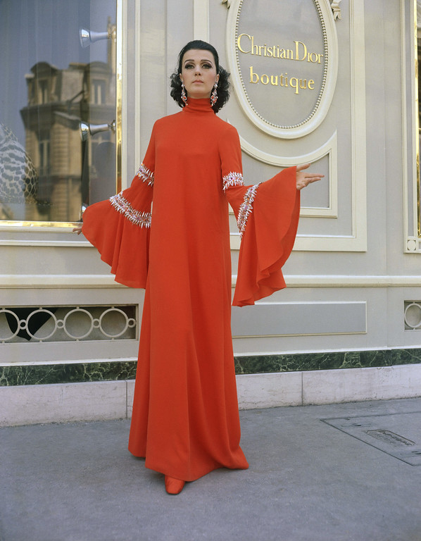 . Encrusted neck, sleeves, & hem fashion French dress in 1967. (AP Photo)