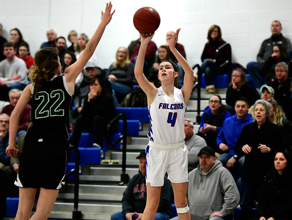 2/28/2019 Mike Orazzi | Staff St. Paul Girls Basketball's Olivia Heslin (4)and Parish Hill's Kaysie Dupuis (22) during the Class S Second Round State Girls Basketball Tournament in Bristol Thursday night.
