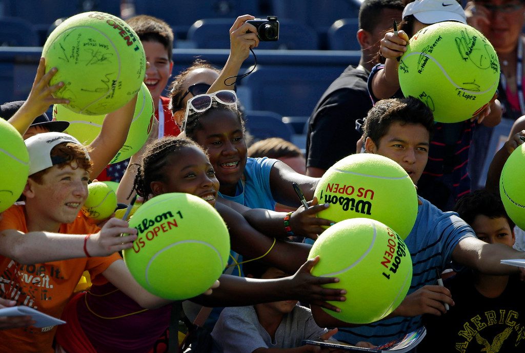 . Fans wait for autographs during the first round of the 2013 U.S. Open tennis tournament Tuesday, Aug. 27, 2013, in New York. (AP Photo/Kathy Willens)