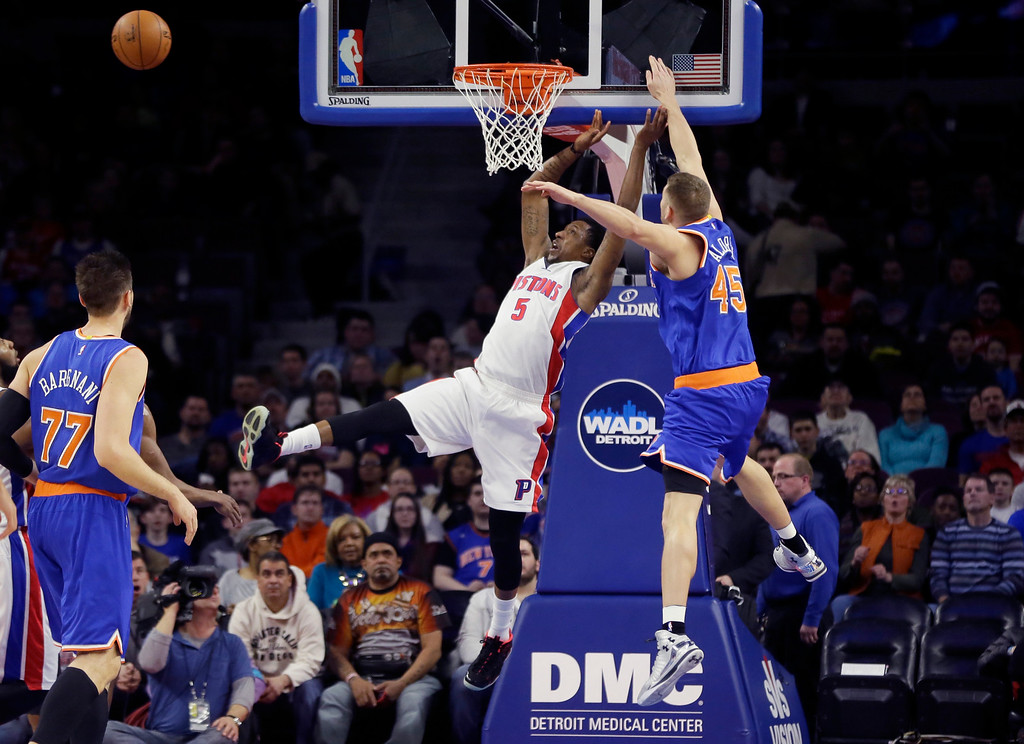 . New York Knicks center Cole Aldrich (45) blocks a shot by Detroit Pistons guard Kentavious Caldwell-Pope (5) during the first half of an NBA basketball game, Friday, Feb. 27, 2015 in Auburn Hills, Mich. (AP Photo/Carlos Osorio)