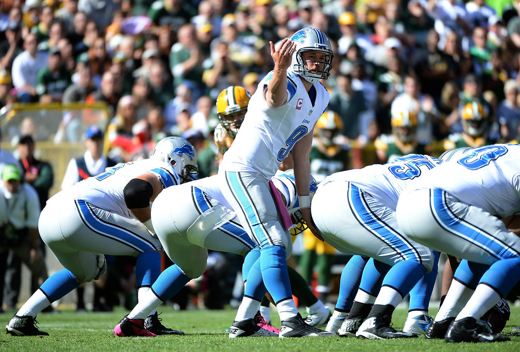 . Matthew Stafford #9 of the Detroit Lions calls a play at the line during the second quarter against the Green Bay Packers at Lambeau Field on October 6, 2013 in Green Bay, Wisconsin.  (Photo by Harry How/Getty Images)