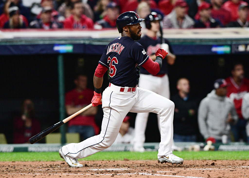 . Cleveland Indians\' Austin Jackson watches his single during the fifth inning against the New York Yankees in Game 5 of a baseball American League Division Series, Wednesday, Oct. 11, 2017, in Cleveland. (AP Photo/David Dermer)