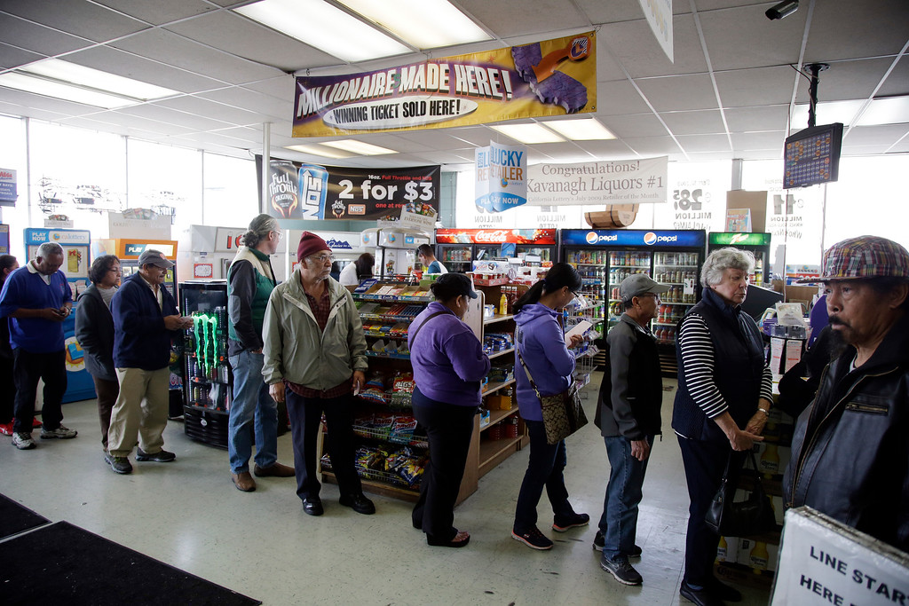 . People line up to buy Powerball lottery tickets at Kavanagh Liquors on Tuesday, Jan. 12, 2016, in San Lorenzo, Calif. The Powerball jackpot has grown to over 1 billion dollars for the next drawing Wednesday. (AP Photo/Marcio Jose Sanchez)