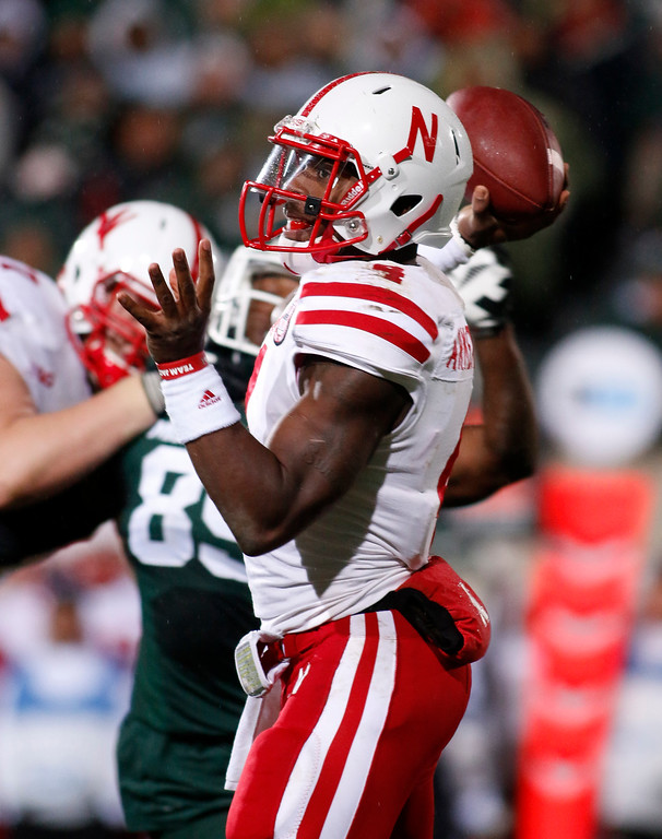 . Nebraska quarterback Tommy Armstrong Jr. throws a pass against Michigan State during the second quarter of an NCAA college football game, Saturday, Oct. 4, 2014, in East Lansing, Mich. (AP Photo/Al Goldis)