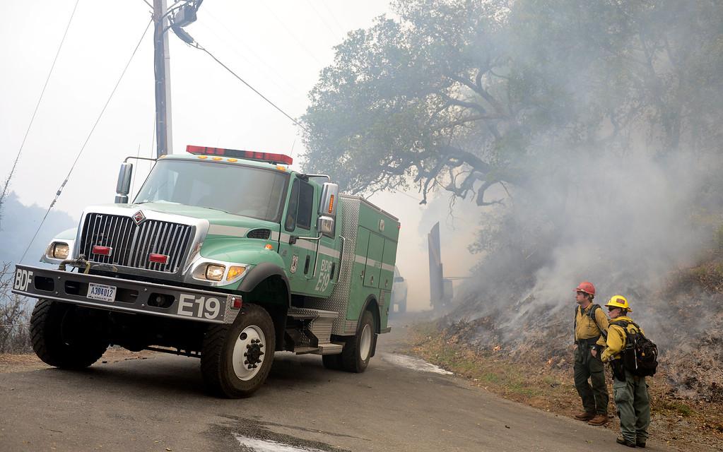. Brush rigs negotiate Pfeiffer Ridge Road in Big Sur, Calif. on Wednesday December 18, 2013. (Photo David Royal/ Monterey County Herald)