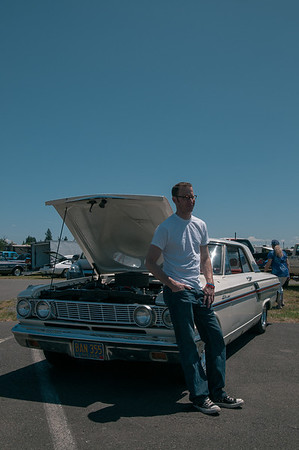 Ryan takes a break to rest on his 1964 Ford Fairlane while drag racing at Woodburn Drag Strip in Woodburn, Oregon