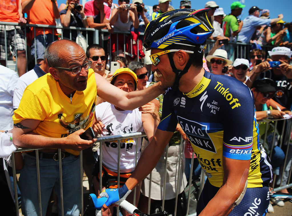 . Alberto Contador of Spain and Team Saxo-Tinkoff chats to race fans at the start of stage three of the 2013 Tour de France, a 145.5KM road stage from Ajaccio to Calvi, on July 1, 2013 in Ajaccio, France.  (Photo by Bryn Lennon/Getty Images)