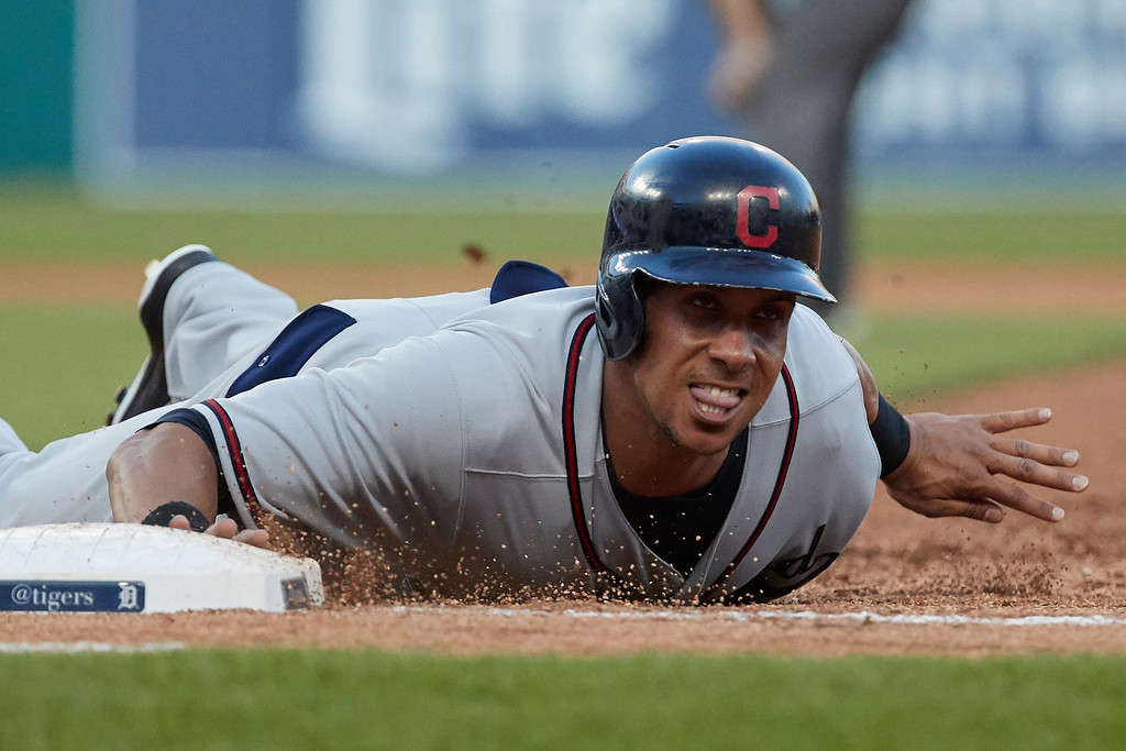 . Cleveland Indians Michael Brantley dives safely back to first baseduring the fourth inning against the Detroit Tigers in the second baseball game of a doubleheader in Detroit, Saturday, July 1, 2017. (AP Photo/Rick Osentoski)