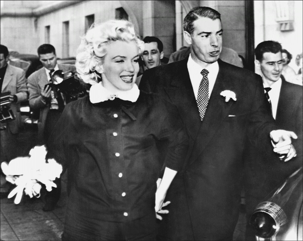 . Picture dated 01 April 1954 showing actress Marilyn Monroe with her second husband American baseball player Joe DiMaggio leaving the city hall of San Francisco after their marriage.  (STF/AFP/Getty Images)