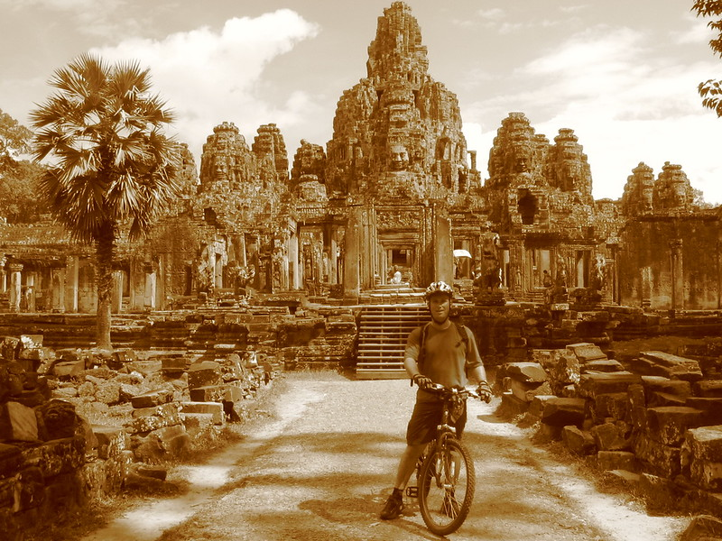 Cycling with the Bayon temple in the background
