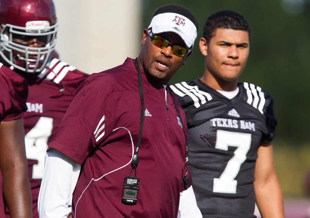 . Texas A&M Head Football Coach Kevin Sumlin watches football practice, Monday, August 5, 2013, in College Station, Texas. (AP Photo/Patric Schneider)