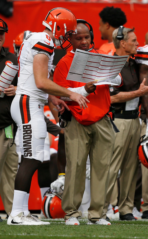 . Cleveland Browns head coach Hue Jackson talks with quarterback Kevin Hogan during the second half of an NFL football game against the New York Jets, Sunday, Oct. 8, 2017, in Cleveland. (AP Photo/Ron Schwane)