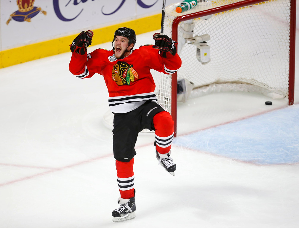 . Chicago Blackhawks center Andrew Shaw celebrates scoring in triple-overtime on Boston Bruins goalie Tuukka Rask (not pictured) to win Game 1 of their NHL Stanley Cup Finals hockey series in Chicago, Illinois, June 13, 2013.   REUTERS/Jeff Haynes