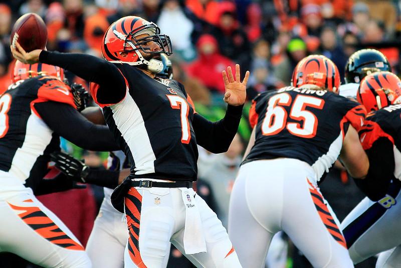 . Cincinnati Bengals quarterback Bruce Gradkowski (7) passes against the Baltimore Ravens in the second half of an NFL football game, Sunday, Dec. 30, 2012, in Cincinnati. The Bengals won 23-17. (AP Photo/Tom Uhlman)