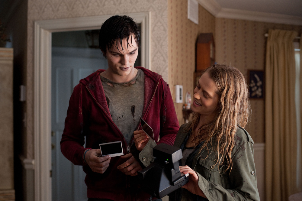 "Description of . This film image released by Summit Entertainment shows Nicholas Hoult, left, and Teresa Palmer in a scene from ""Warm Bodies.\"" (AP Photo/Summit Entertainment, Jonathan Wenk)"
