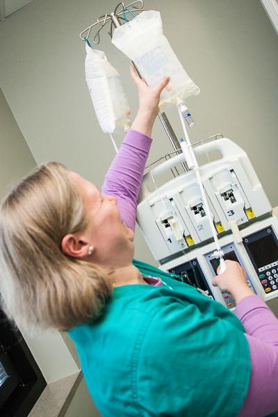Devi Hale hangs saline at Intergris Baptist Medical Center in Oklahoma City.