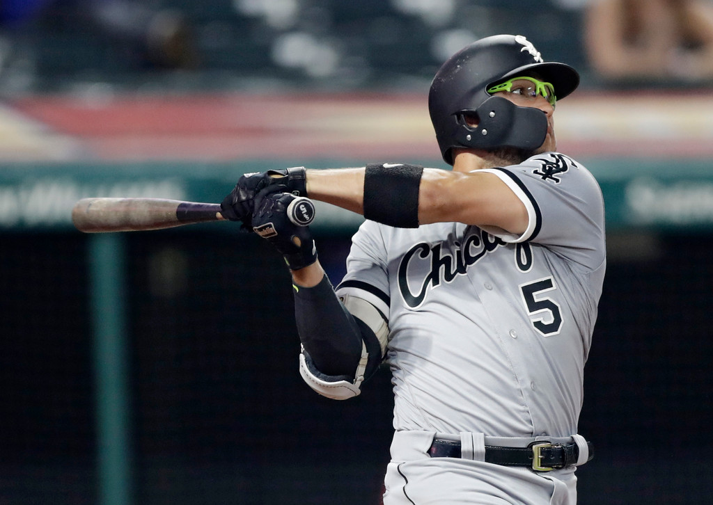 . Chicago White Sox\'s Yolmer Sanchez hits an RBI-single off Cleveland Indians relief pitcher Evan Marshall in the eighth inning of a baseball game, Monday, June 18, 2018, in Cleveland. Adam Engel scored on the play. (AP Photo/Tony Dejak)