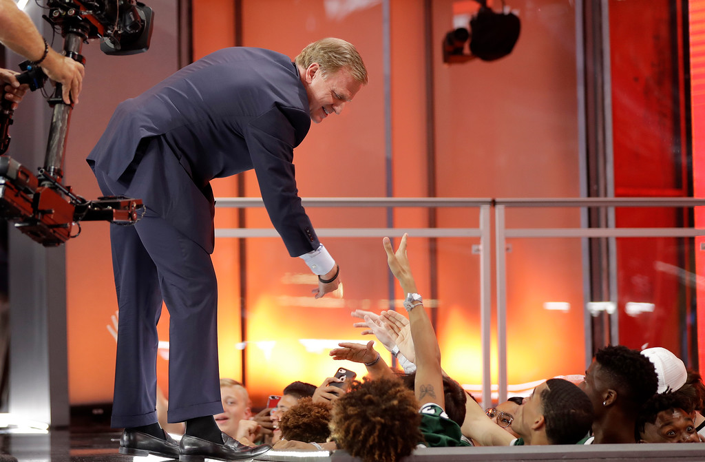 . NFL commissioner Roger Goodell greets fans during the first round of the NFL football draft, Thursday, April 26, 2018, in Arlington, Texas. (AP Photo/David J. Phillip)