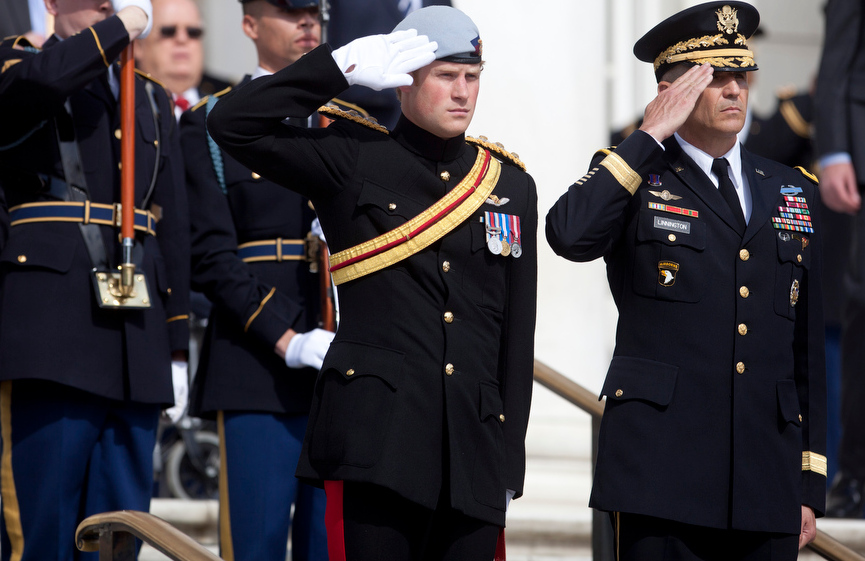 . Britain\'s Prince Harry and Major General Michael Linnington, right, salute during a wreath laying ceremony at the Tomb of the Unknowns at Arlington National Cemetery in Arlington, Va., Friday, May 10, 2013. (AP Photo/Carolyn Kaster)