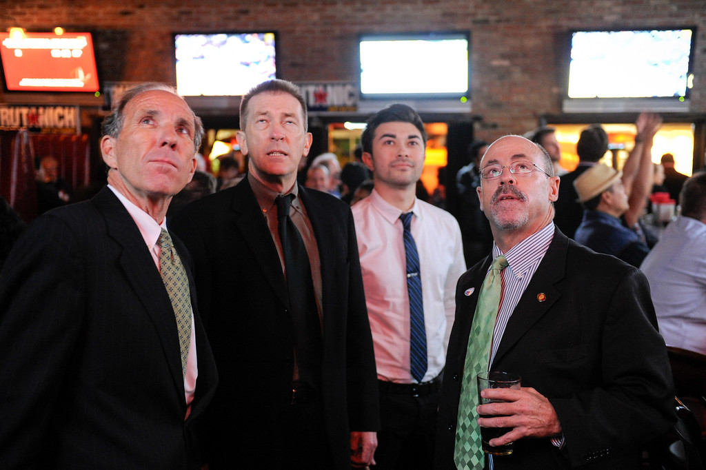 . Workers from the city attorney\'s office, from left, William Carter, Doug Green, Russell Green and Sandy Cooney watch election returns at the campaign party for Carmen Trutanich at Rocco\'s Tavern in Studio City, Tuesday, March 5, 2013. (Michael Owen Baker/Staff Photographer)