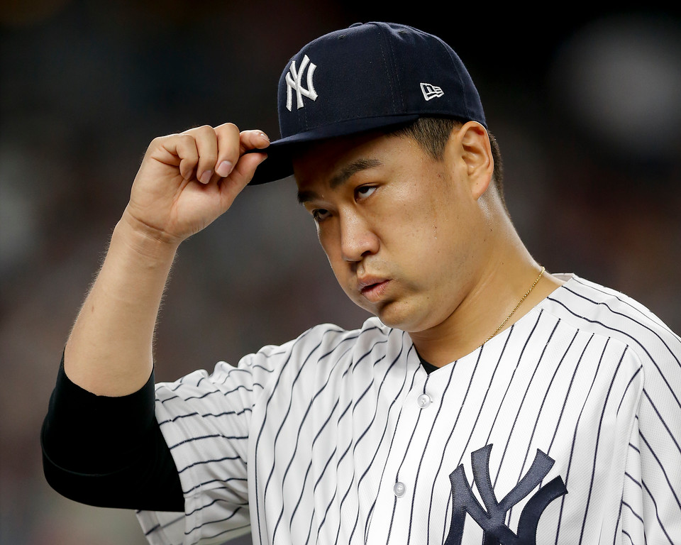 . New York Yankees pitcher Masahiro Tanaka (19) walks off the field at the end of the second inning against the Cleveland Indians in Game 3 of baseball\'s American League Division Series, Sunday, Oct. 8, 2017, in New York. (AP Photo/Kathy Willens)