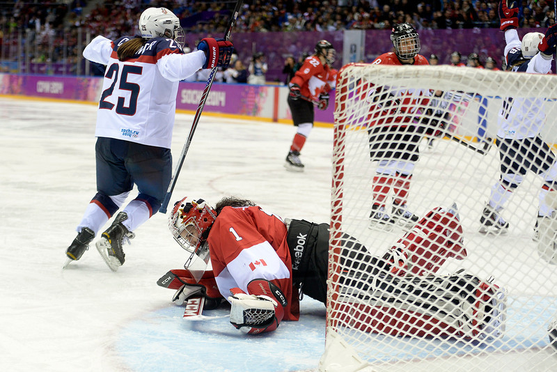 . Shannon Szabados (1) of the Canada falls to the ground after giving up a 2-0 goal to Alex Carpenter (25) of the U.S.A. during the third period of the women\'s gold medal ice hockey game. Sochi 2014 Winter Olympics on Thursday, February 20, 2014 at Bolshoy Ice Arena. (Photo by AAron Ontiveroz/ The Denver Post)