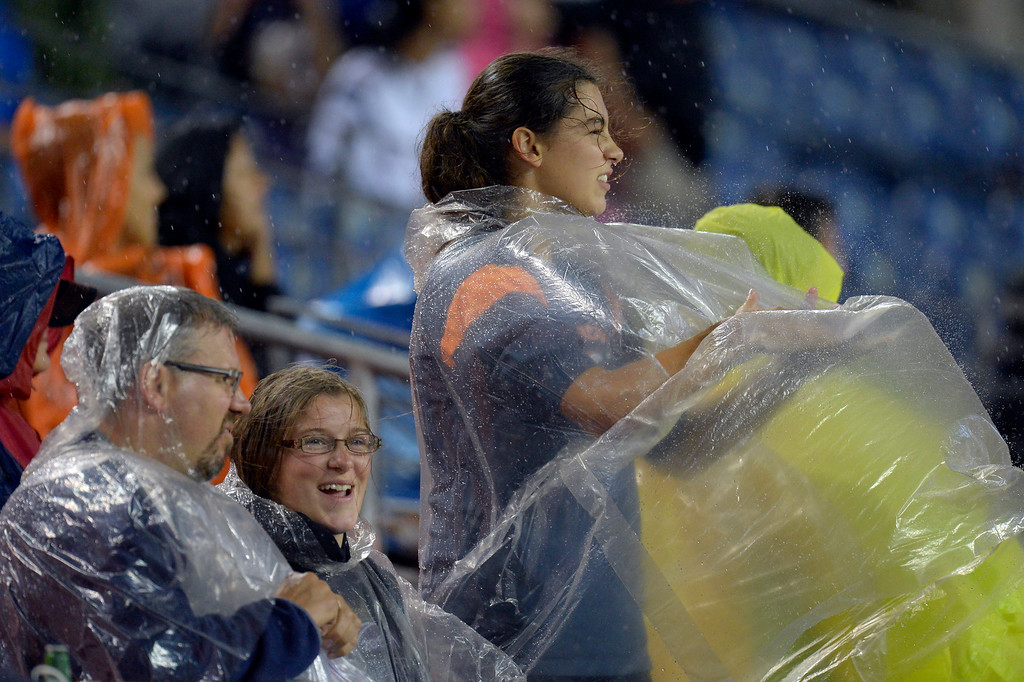 . DENVER, CO. - AUGUST 17: Denver Broncos fans cover up in the fourth quarter as the rain came down against the St. Louis Rams August 24, 2013 at Sports Authority Field at Mile High. (Photo By John Leyba/The Denver Post)