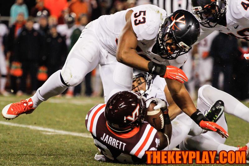 Kyshoen Jarrett gets tackled by Micah Kiser during a punt return in the first quarter. (Mark Umansky/TheKeyPlay.com)
