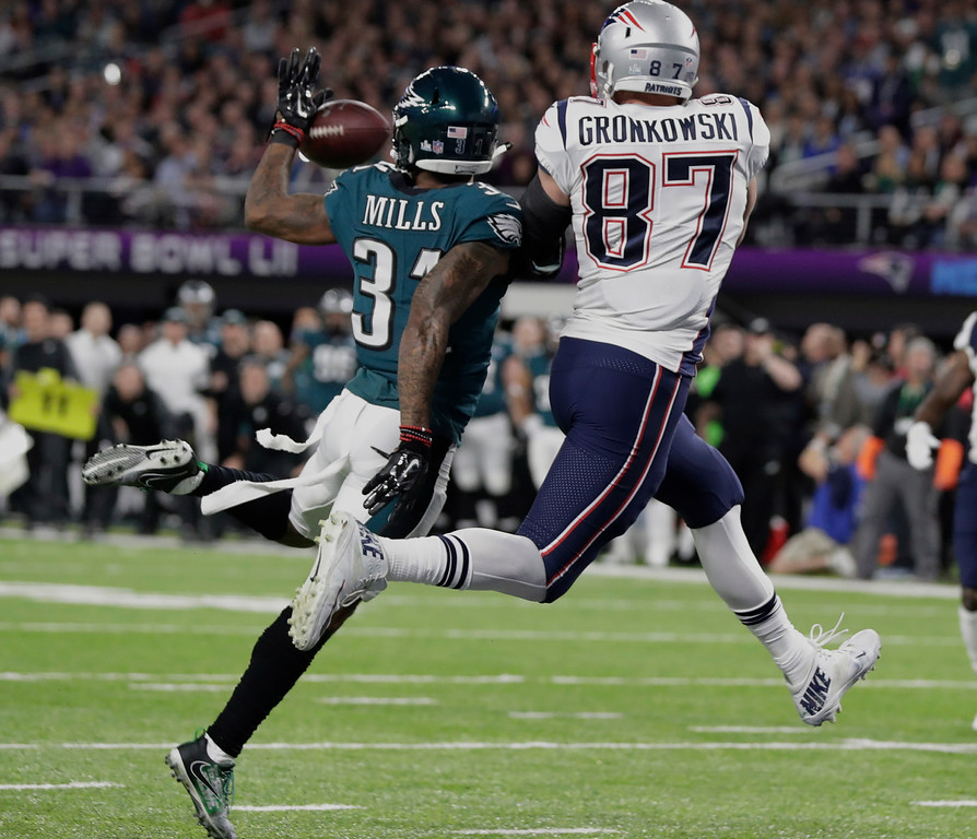 . Philadelphia Eagles cornerback Jalen Mills (31), breaks up a pass intended for New England Patriots tight end Rob Gronkowski (87), during the first half of the NFL Super Bowl 52 football game Sunday, Feb. 4, 2018, in Minneapolis. (AP Photo/Tony Gutierrez)