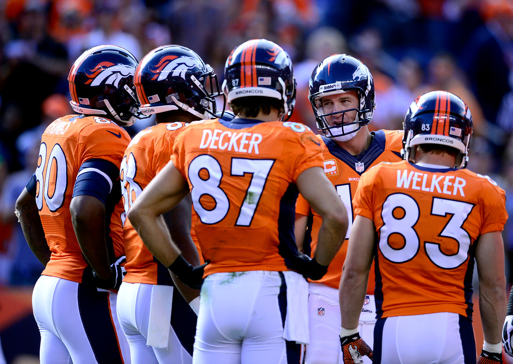 . Denver Broncos quarterback Peyton Manning (18) with his four horsemen, tight end Julius Thomas (80),  wide receivers Demaryius Thomas (88), Eric Decker (87) and Wes Welker (83.)  (Photo by AAron Ontiveroz/The Denver Post)
