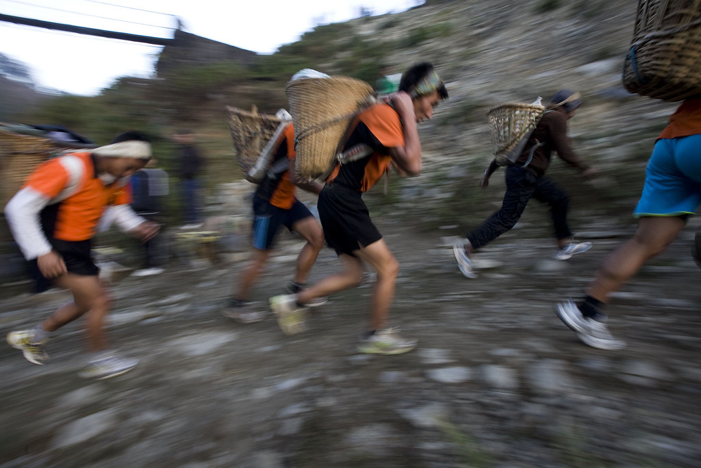 . Nepalese youths run as they carry baskets locally known as \'Doko\' containing 25 kg of stones during a physical training session, organized by a private institute in Phokhara who prepares them for the British Gurkha soldier recruitment selection, at Malam Mountain in Kaski district, Nepal, 18 November 2012. The British Gurkha soldier recruitment selection process started on 23 November and runs untill the end of December 2012 at British Gurkha camp situated in Pokhara City, Nepal. Around 125 youths will be selected from more than three thousands participants. Those selected will join the British Army, a selection which carries much prestige and admiration throughout Nepalese society.  EPA/NARENDRA SHRESTHA