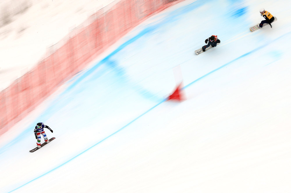 . (L-R) Raffaella Brutto of Italy, Faye Gulini of the USA and Chloe Trespeuch of France descend the course during the semi finals in the USANA Snowboardcross World Cup Team Event on December 15, 2012 in Telluride, Colorado.  (Photo by Doug Pensinger/Getty Images)