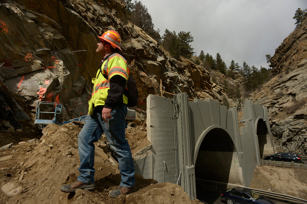. IDAHO SPRINGS, CO- MARCH 28:  Mike Keleman, a project engineer with CDOT, oversees rock work directly above the twin tunnels on the east side of the tunnels.  Crews will be expanding the size of the tunnels and will be blasting some of the rock to do that.  Construction continues on road work on I-70 and the twin tunnels near Idaho Springs on March 28th, 2013.  The highway is being widened in the east bound lanes.  The widening will start just west of the twin tunnels after Idaho Springs and will continue until the exit for Highway 6 where I-70 becomes three lanes.  They expect the project to be finished by the end of 2013.  (Photo By Helen H. Richardson/ The Denver Post)